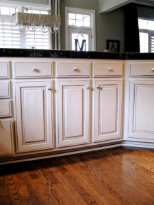 Beautiful off white cabinets with dark gray glaze